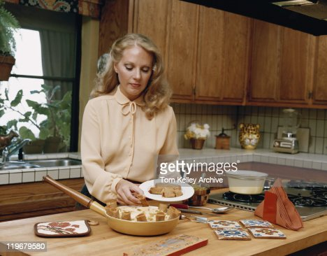 Young woman serving roulade in plate : Stock Photo