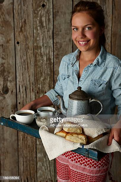 Young woman serving southern style breakfast on a tray