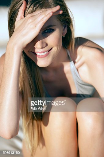 Young woman shading her eyes from the sun : Stock Photo
