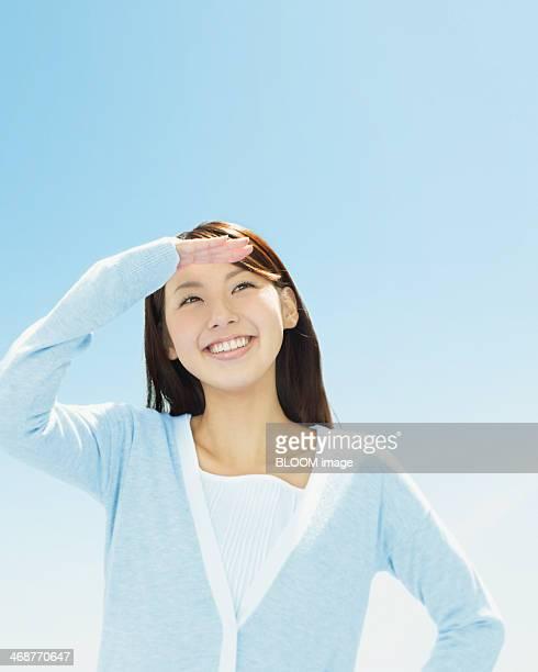 Young Woman Shielding Eyes