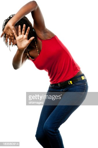 Young Woman Shields Herself With Hands