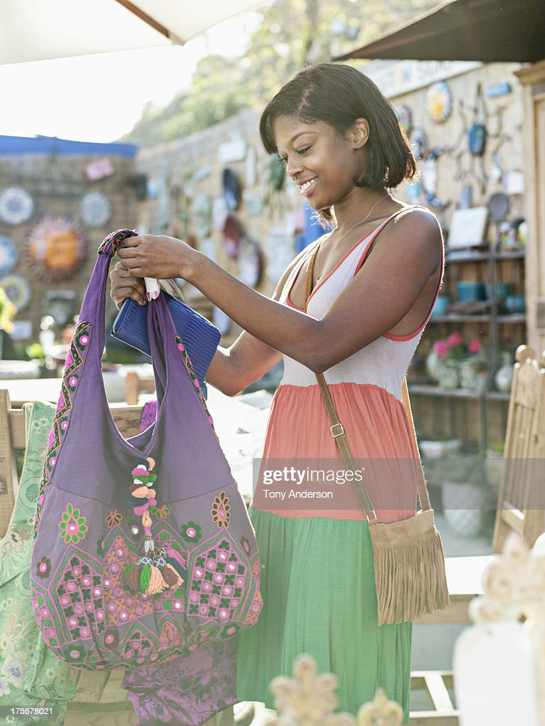 Young woman shoping in open air market : Stock Photo