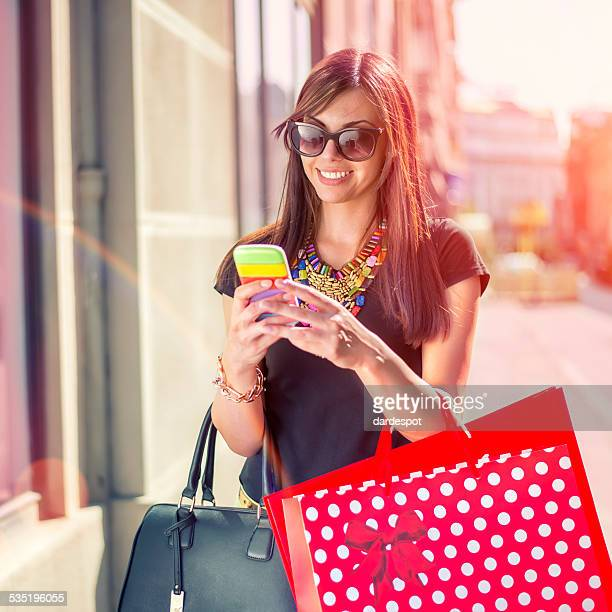 Young Woman Shopping and using mobile phone