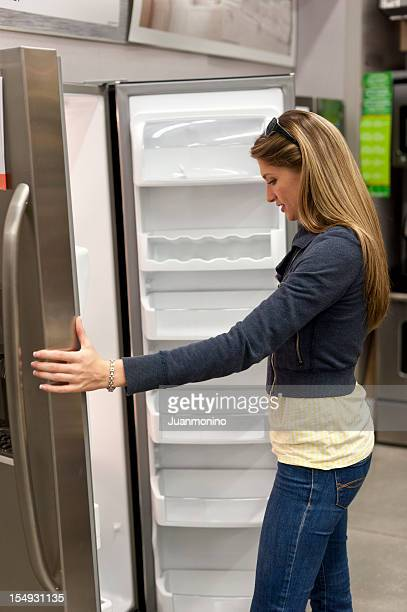 Young woman shopping for a refrigerator