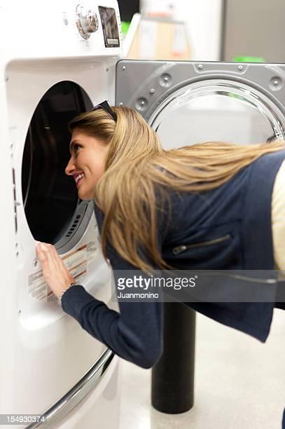 Young woman shopping for a washing machine