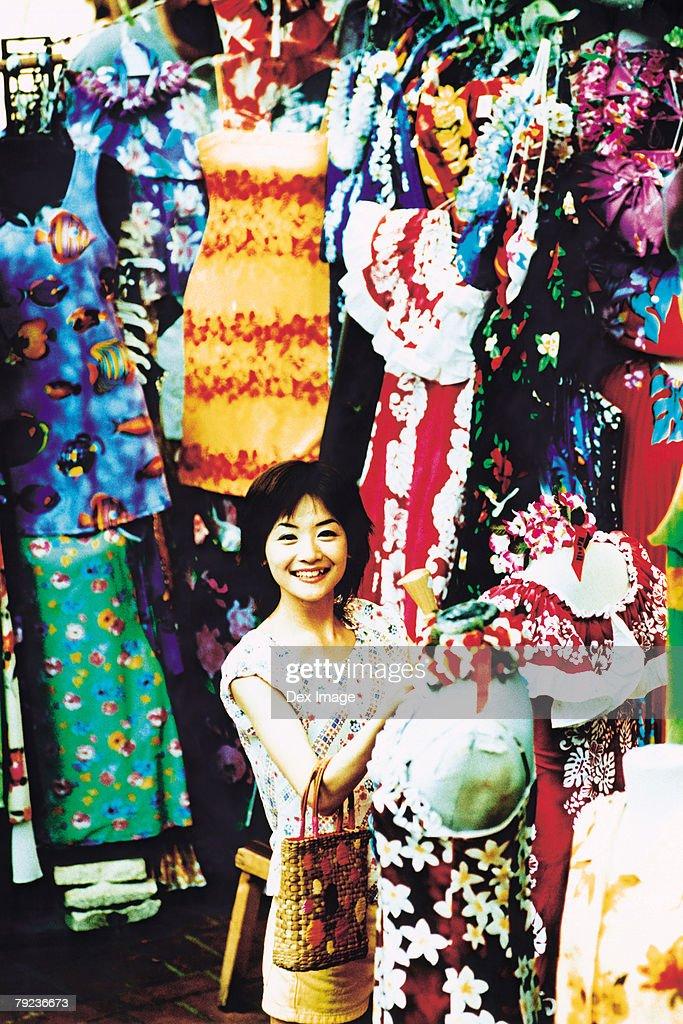 Young woman shopping for Hawaiian blouse : Stock Photo