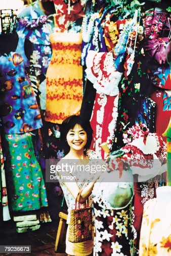Young woman shopping for Hawaiian blouse : Stock Photo