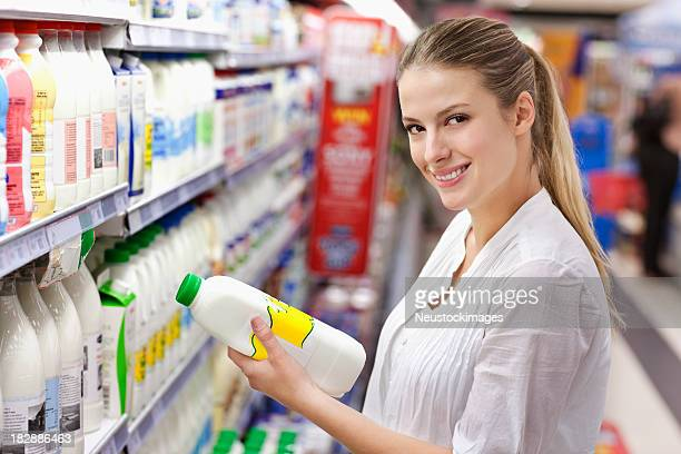 Young Woman Shopping for Milk