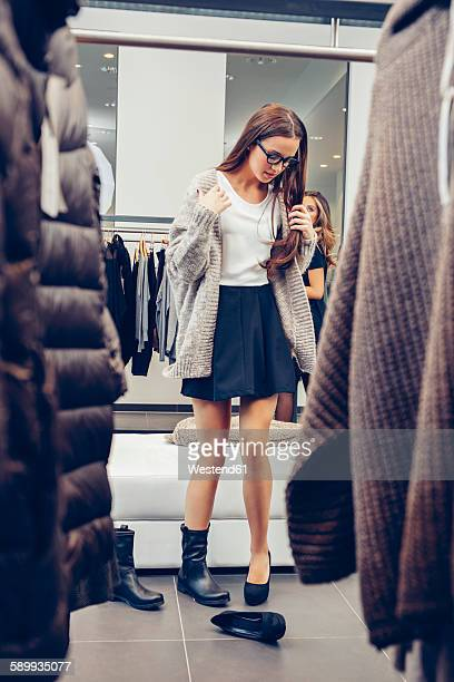 Young woman shopping for shoes in a boutique