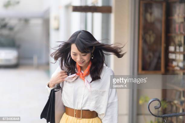 Young woman shopping in city, hair flipped