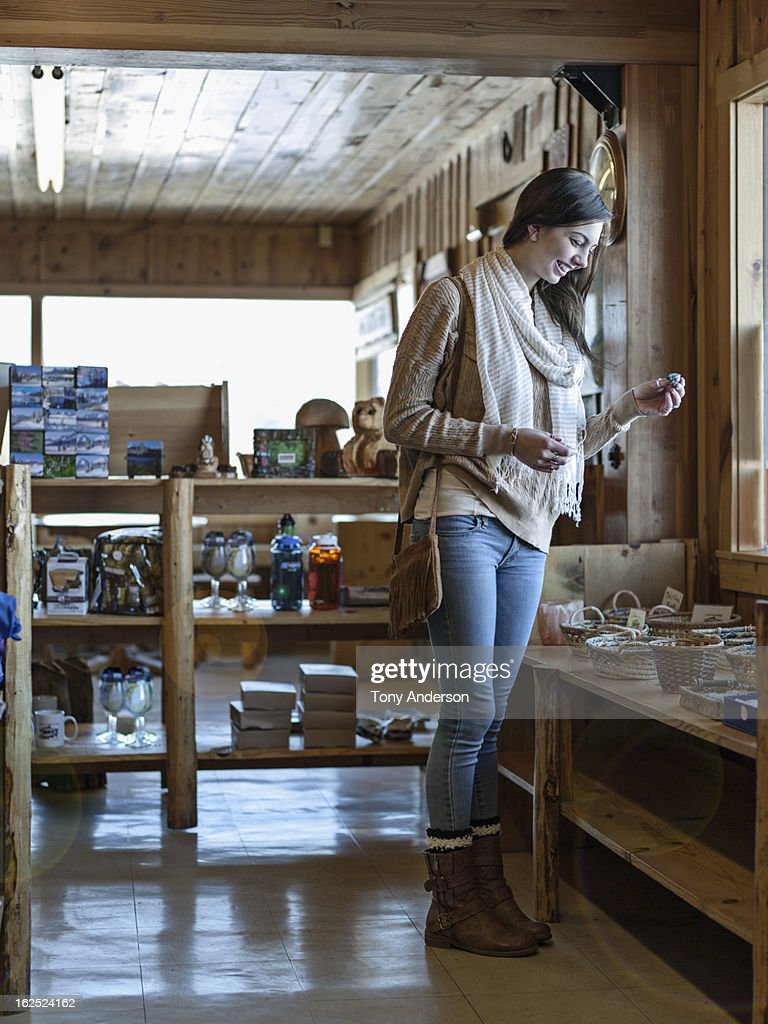 Young woman shopping in country store : Stock Photo