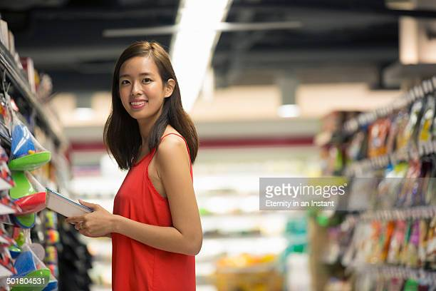 Young woman shopping in grocery store.