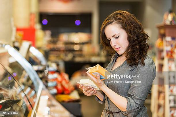 Young woman shopping in organic market for her groceries