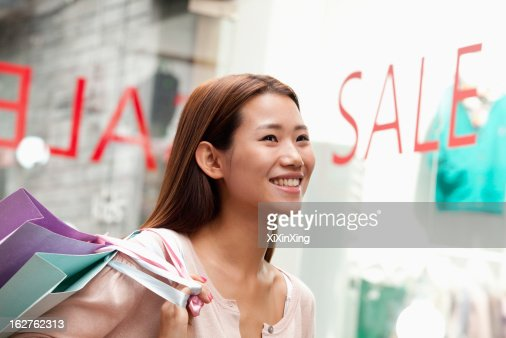 Young woman shopping Looking away : Stock Photo