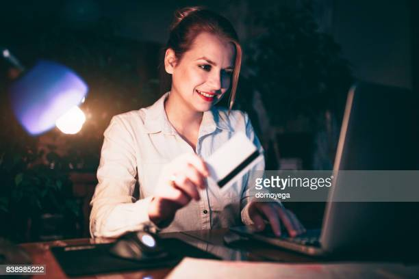 Young woman shopping online from home