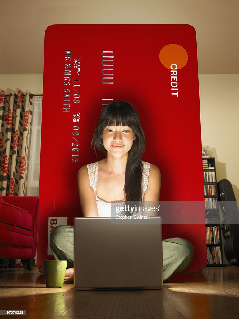 A young woman shopping online with credit card