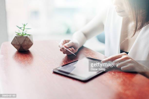 Young woman shopping online with digital tablet