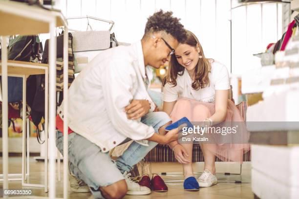 Young woman shopping shoes