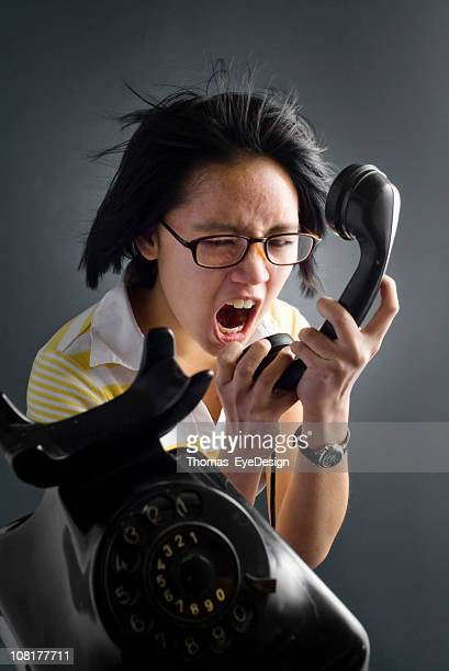Young Woman Shouting into Phone