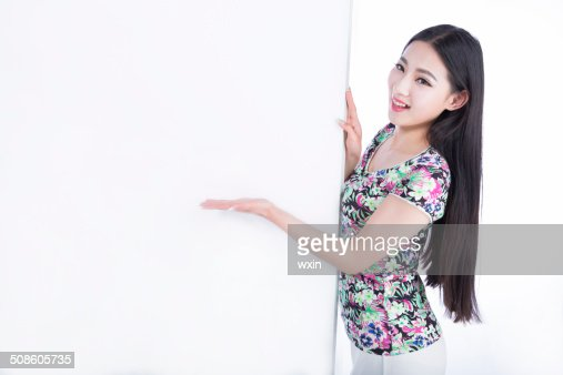 young woman showing blank signboard, isolated on white background : Stock Photo