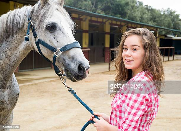 Young woman showing his horse