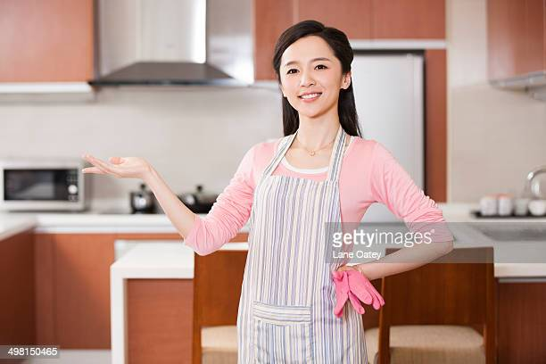 Young woman showing kitchen