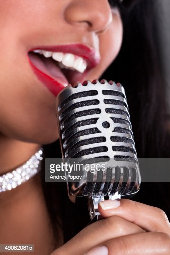 Young Woman Singing In Microphone : Stock Photo