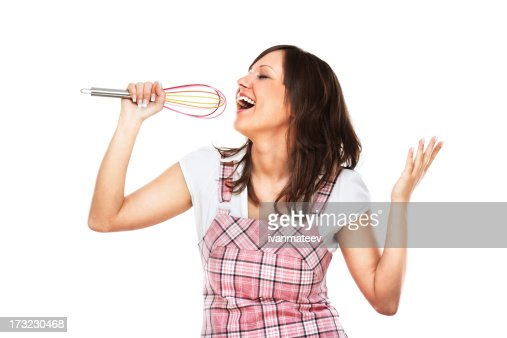 Young woman singing with egg beater