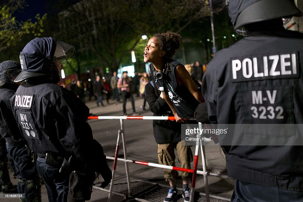 A young woman sings to riot police at the conclusion of a mostly peaceful demonstration by several thousand left-wing protesters on May Day on May 1, 2013 in Berlin, Germany. May Day, the international day of labour, is a national holiday in Germany and observed with gatherings by labour unions and political parties. In some cities, including Hamburg and Berlin, the day often ends with violent clahes between police and mostly left-wing demonstrators.