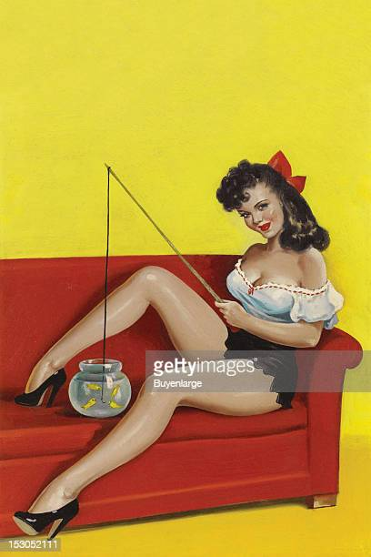 Young woman sits on a couch holding a toy fishing rod and dipping the line into a fishbowl 1949 By Peter Driben