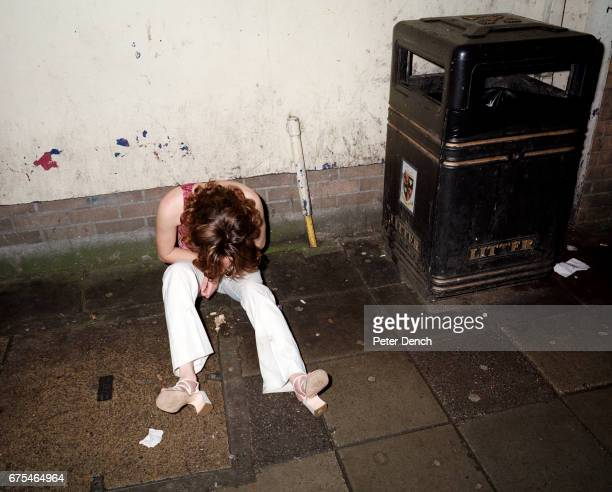 A young woman sits on the pavement of Union Street on a night out in Plymouth November 2001