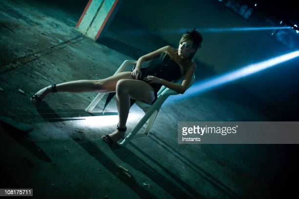 Young WOman Sitting Abandoned Warehouse