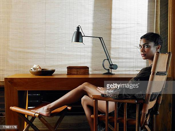Young Woman Sitting at Desk in Study