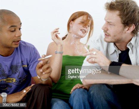 Her Men smoking cigarettes