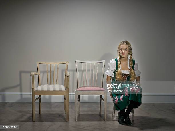 Young Woman Sitting in Chairs