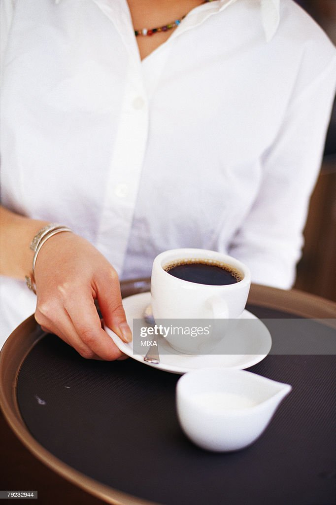 A young woman sitting in coffee shop : Stock Photo