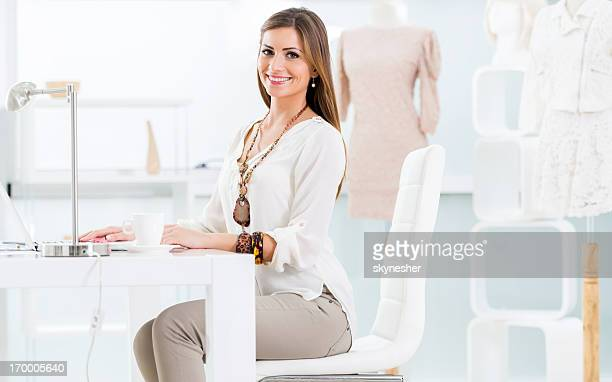Young woman sitting in design studio.