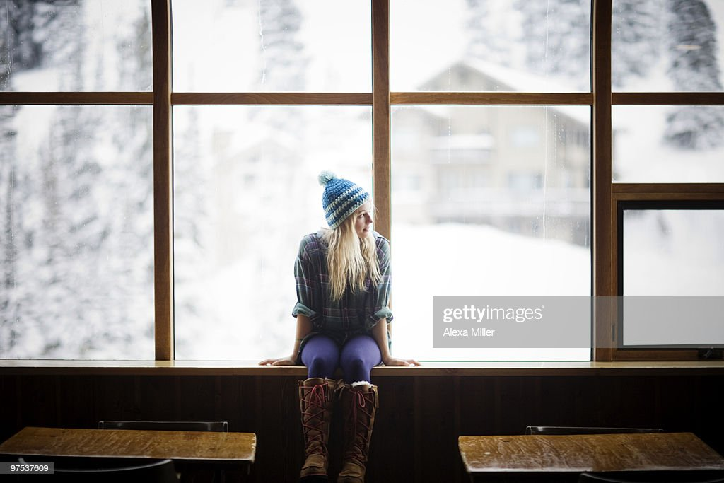 Young Woman Sitting In Window Stock Photo Getty Images
