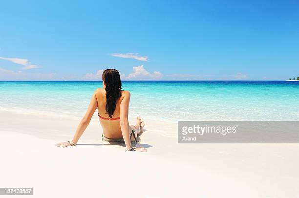 young woman sitting on a beach