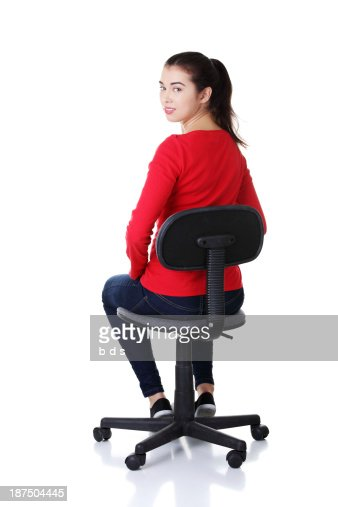 Young woman sitting on a chair. : Stock Photo