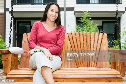 Young woman sitting on porch swing