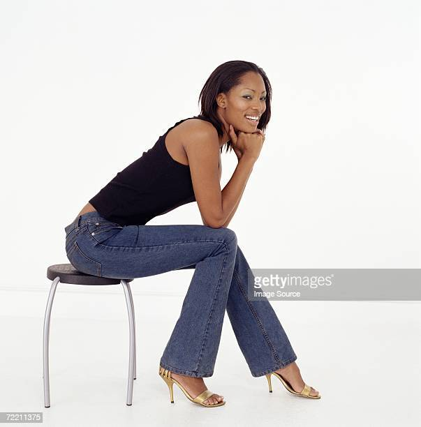 Woman On Chair Side Profile Stock Photos And Pictures