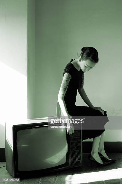 Young Woman Sitting on Vintage Television, Black and White