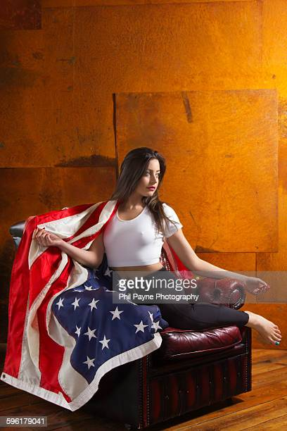 Young woman sitting with American flag