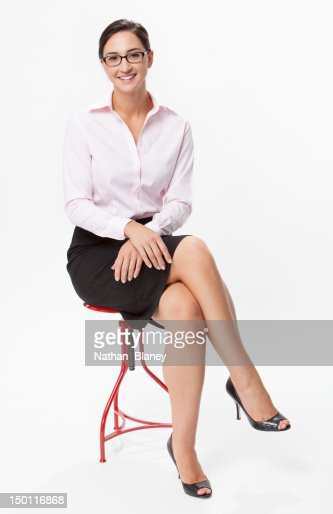 Young Woman Sitting With Legs Crossed Stock Photo Getty