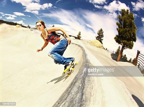 Young woman skateboarding at California skate park
