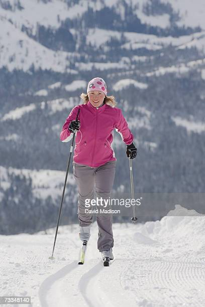 Young woman skiing cross country