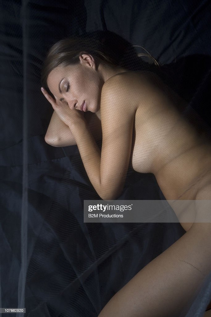Young woman sleeping in Bed : Stock Photo