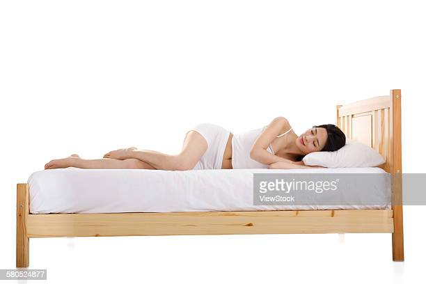 Young woman sleeping in the bedroom