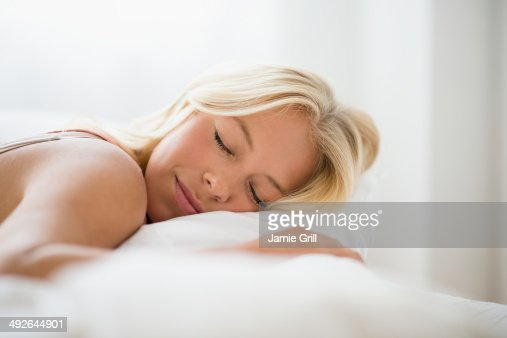Young woman sleeping, Jersey City, New Jersey, USA